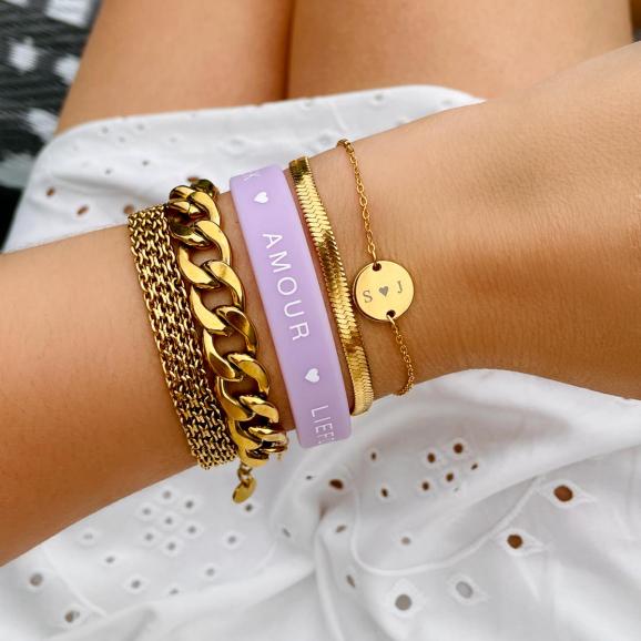 Mooie goudkleurige armbanden mrt roze armbandje