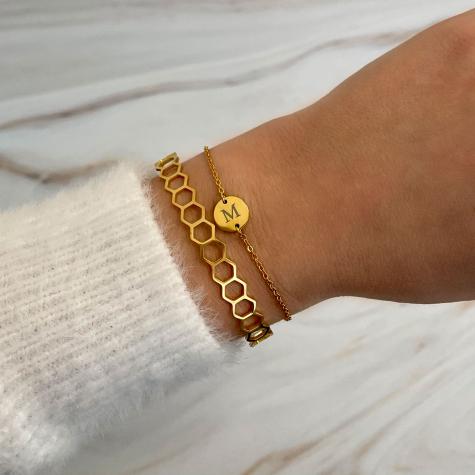 Minimalistische bangle hexagon goud kleurig
