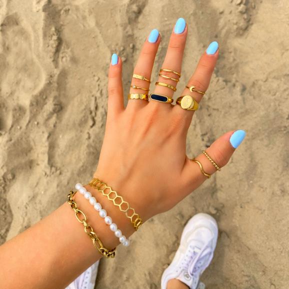 Gouden ringen om hand