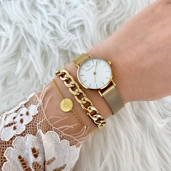 Gouden horloge met armbanden gecombineerd