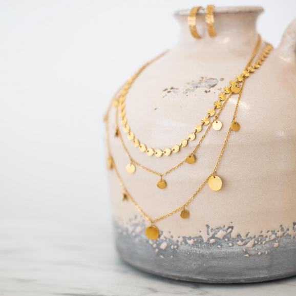 Mooie mix van muntjes kettingen in het goud kleurig