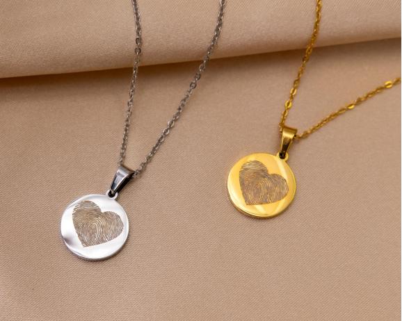 Gouden en zilveren ketting met vingerfadruk