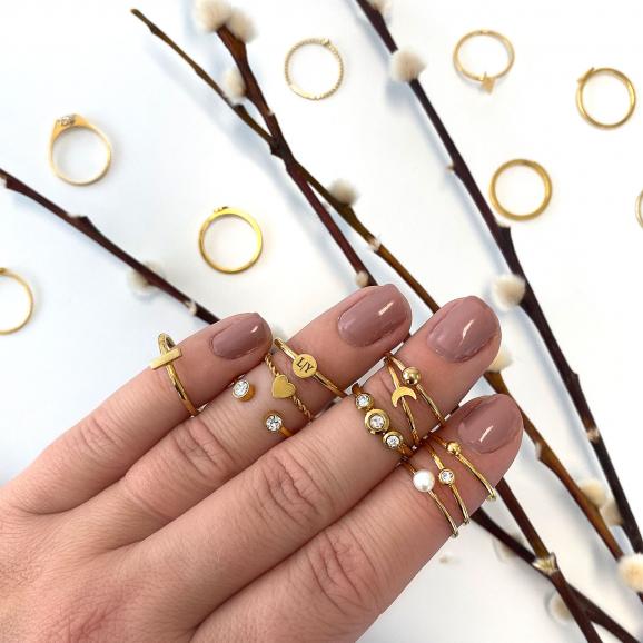 Graveerbare minimalistische ring met muntje goud kleurig