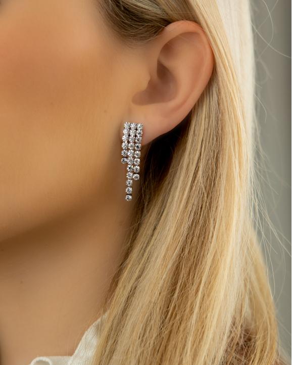 Zilveren tennis oorbellen luxury in oor
