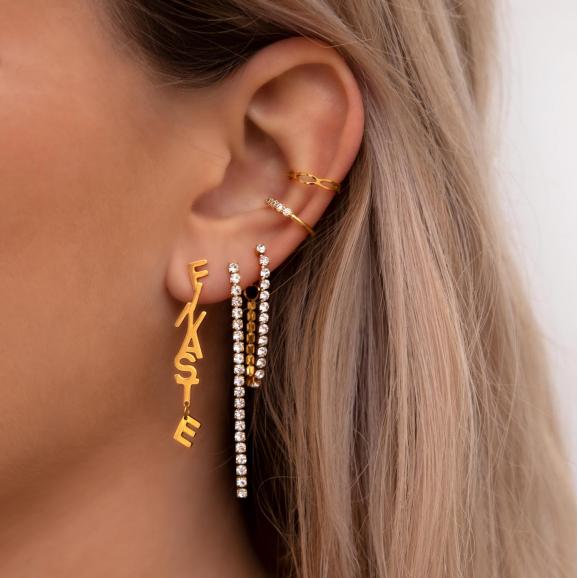 Tennis oorbellen met kettinkje goud kleurig