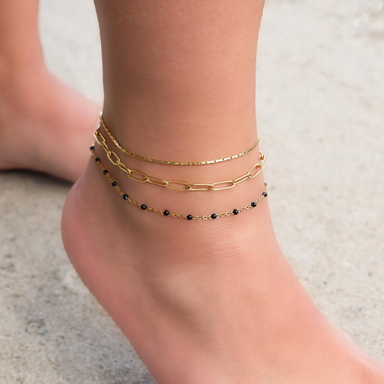 goudkleurige enkelbandjes om de enkel om te shoppen