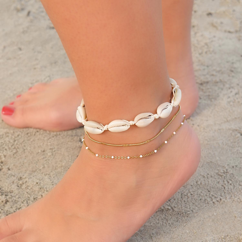 Trendy enkelbandje met schelpjes om de voet