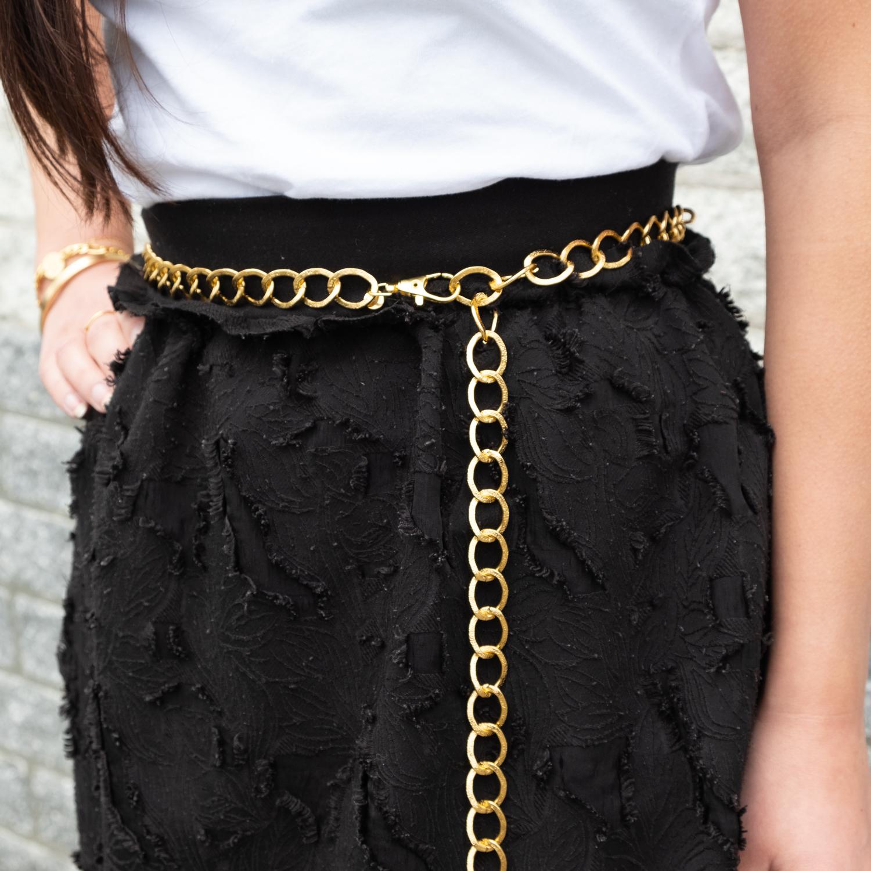 Trendy chain belt om de taille met gouden details