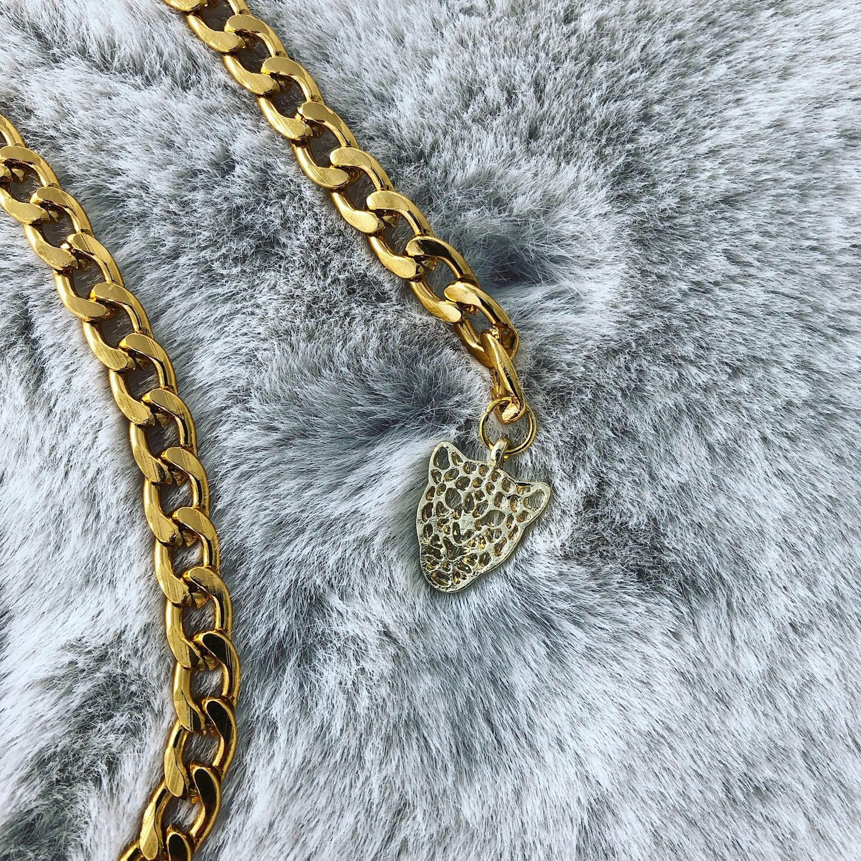 Gouden Chain belt met een panter aan het einde