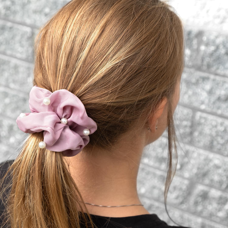 Leuke haaraccessoire in de kleur lila met parels