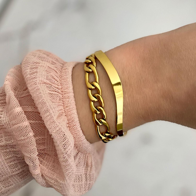 Gouden bangle met chain armband gecombineerd