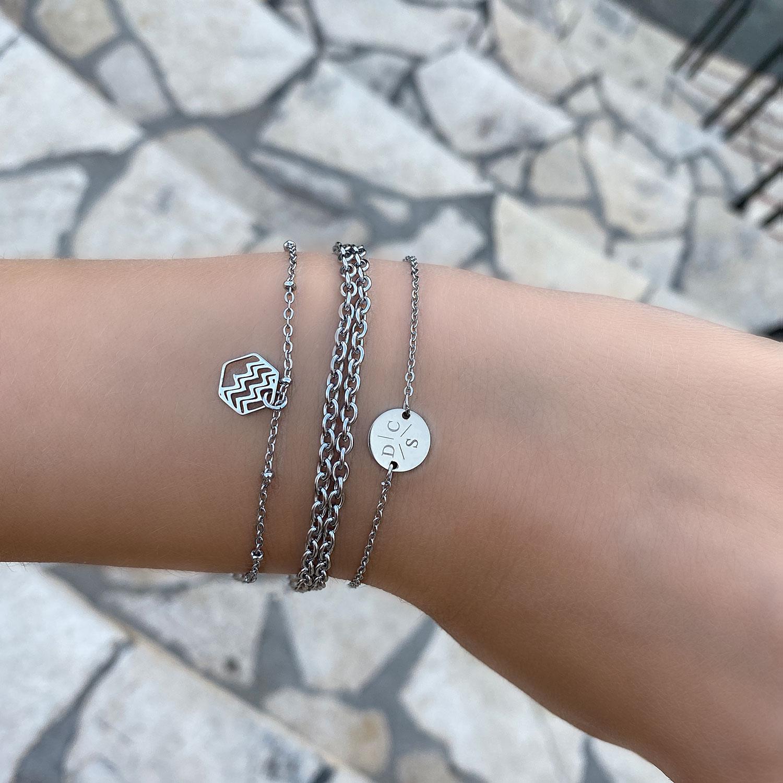 Zilveren armparty om de pols met sterrenbeeld