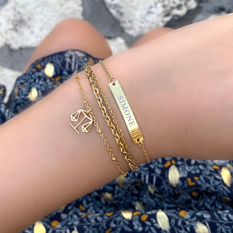 Leuke gouden armbanden om de pols met sterrenbeeld