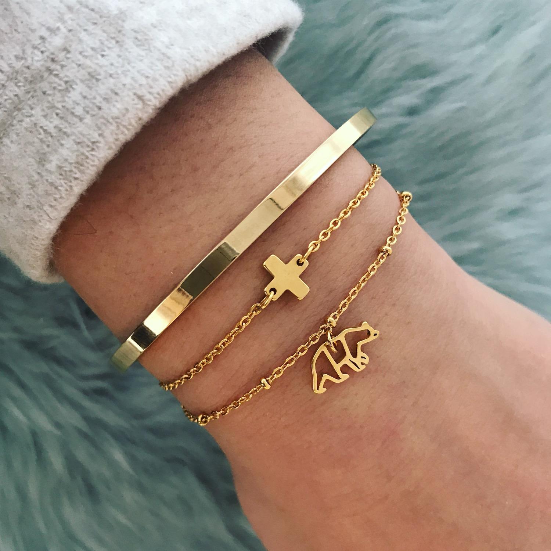 Gouden plus armband in combinatie met andere