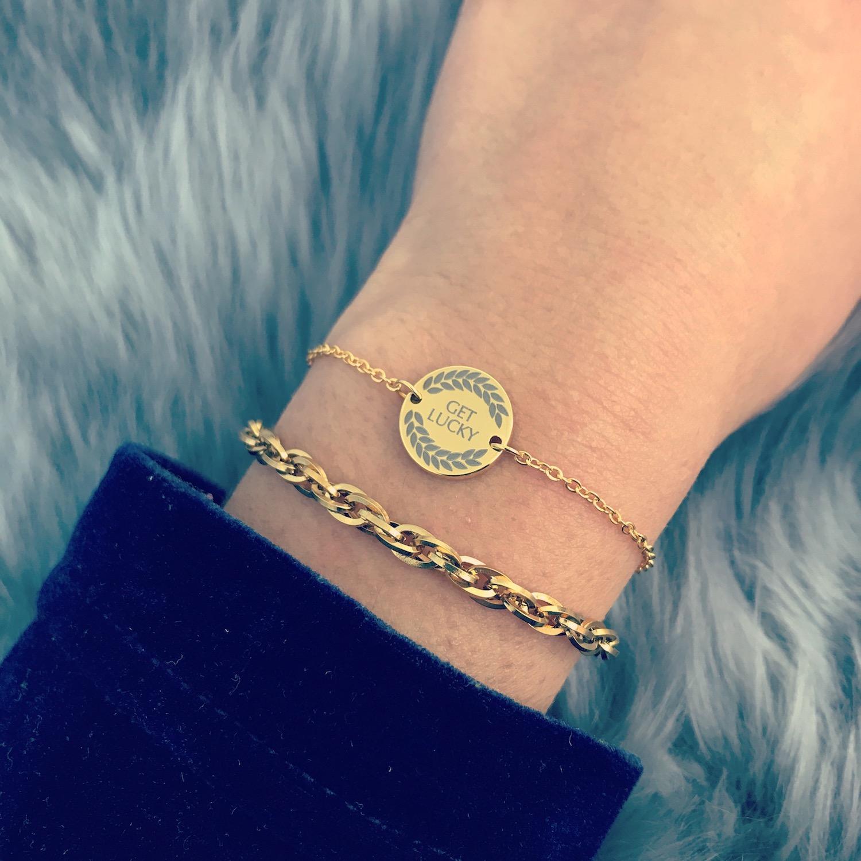 Gouden lucky armbandje met schakelarmbandje gecombineerd
