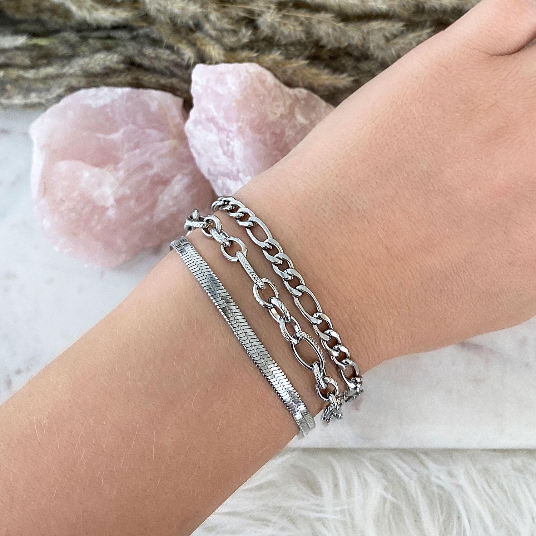 Zilveren schakelarmbanden combinatie met roze stenen