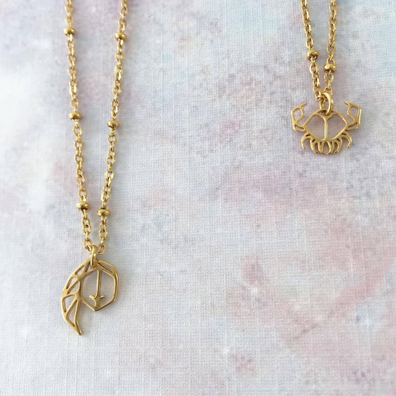 Gouden sterrenbeeld kettingen van maagd en kreeft