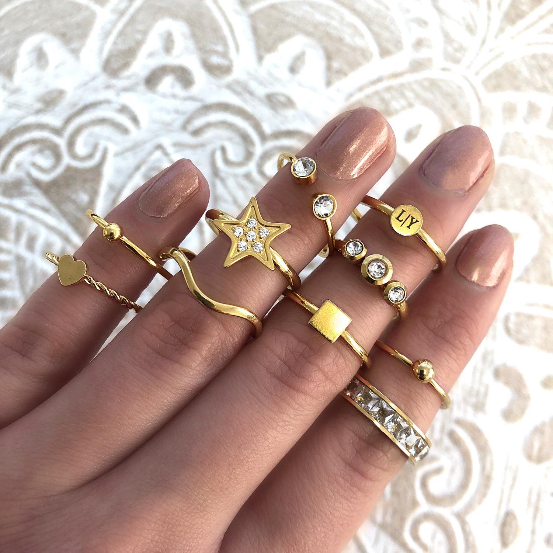Leuke gouden ringen om de hand met meerdere setjes
