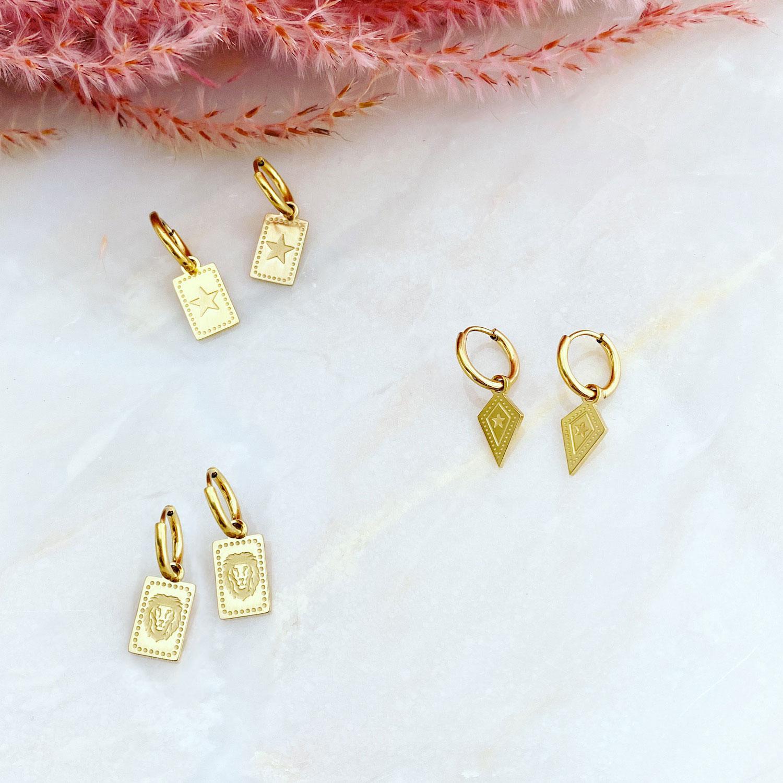 Gouden oorbellen met hanger gemixt