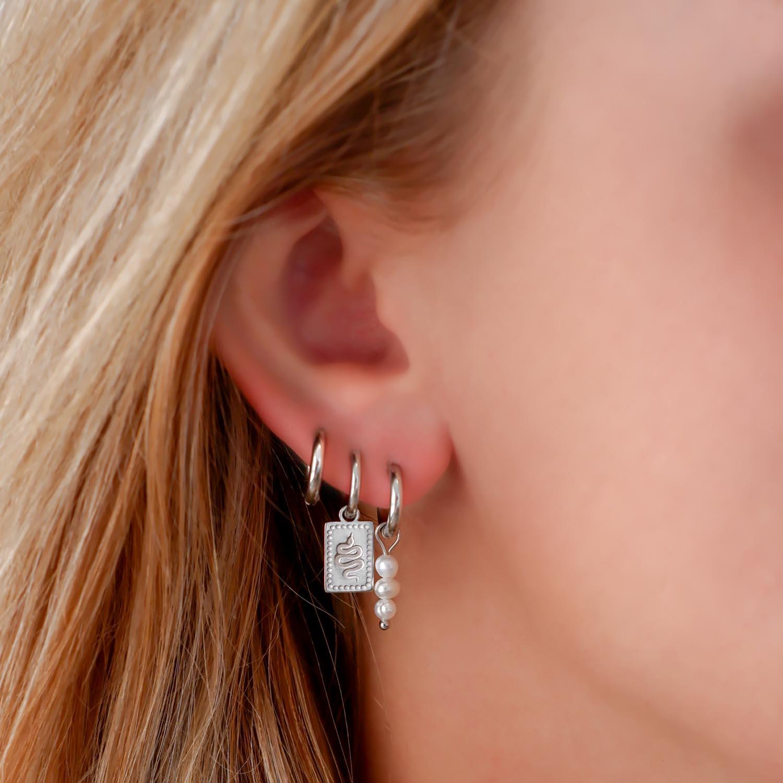 Mooie earparty met parel details voor een complete look