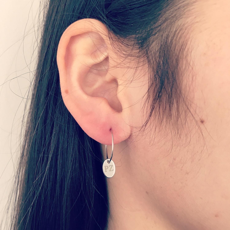 Zilveren oorbellen met graveerbaar ovale hanger