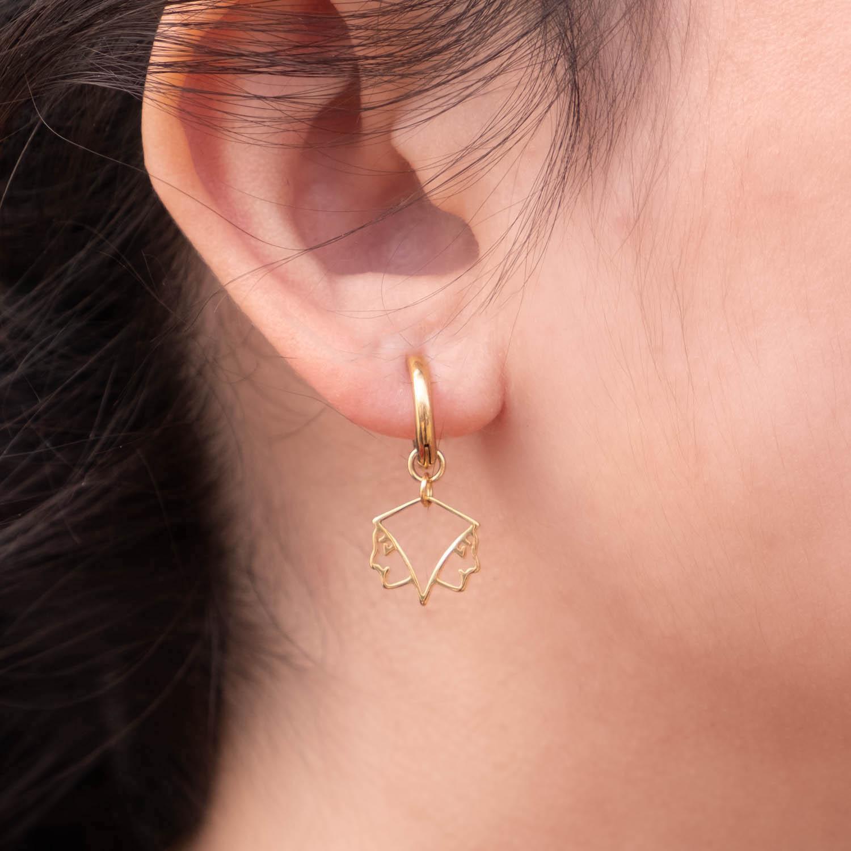 Gouden oorringetjes met het sterrenbeeld tweeling