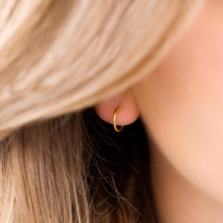 Gouden earparty met oorringetjes