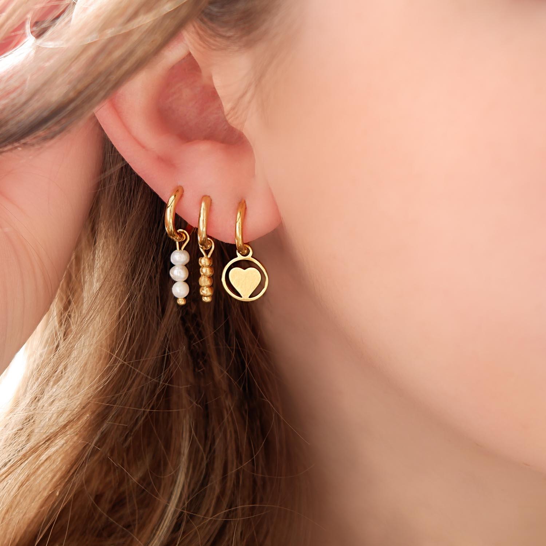 Oorbellen met een ster al hanger met earparty