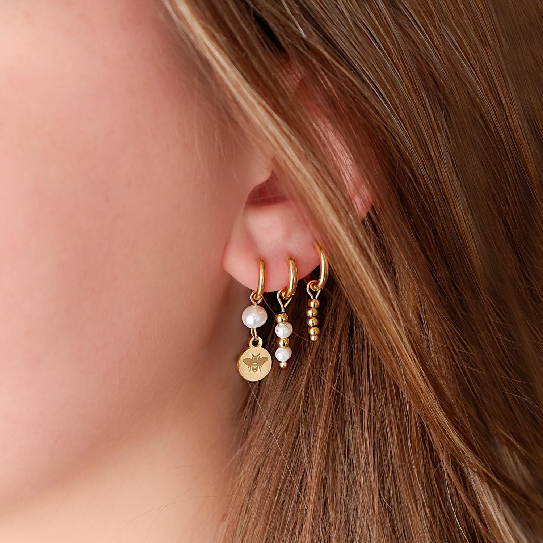 Gouden oorbellen voor een trendy look om te kopen