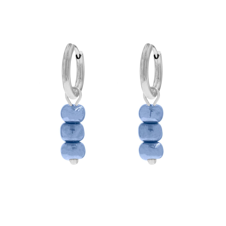 Zilveren oorringetjes met blauwe steentjes