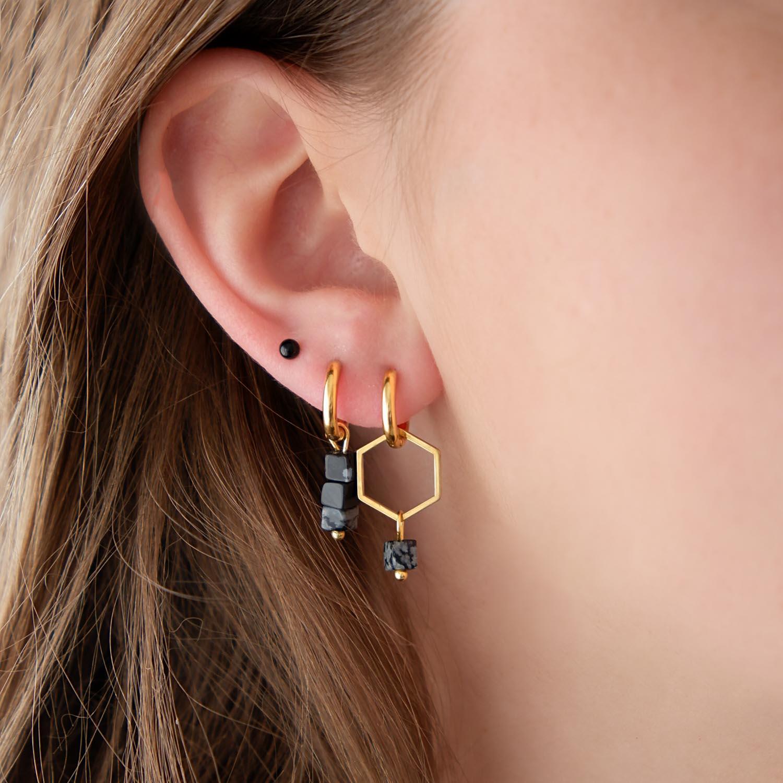 Hexagon oorbellen met marmer in oor