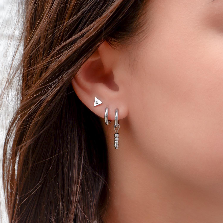 Trendy ear party in het oor voor een complete look