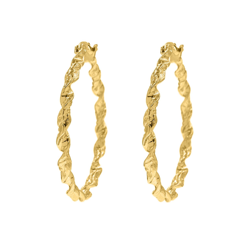 Gedraaide oorringen goud kleurig