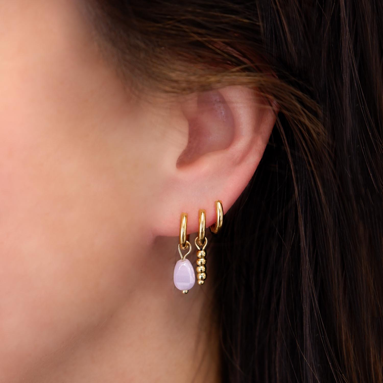 Trendy earparty in het oor voor een complete look