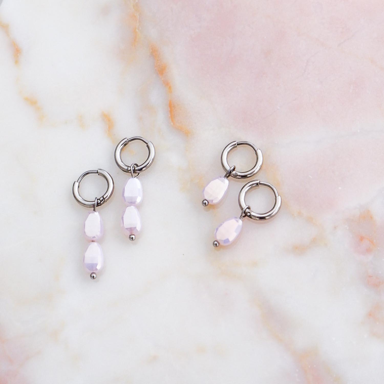 Trendy sieraden met een lila steentje om te kopen