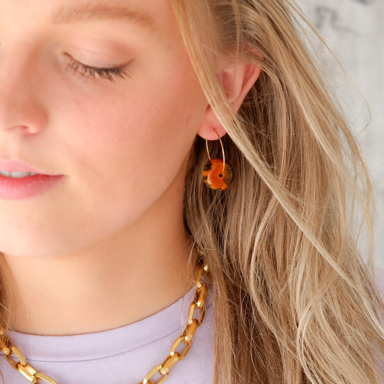 Trendy oorbellen met kraal voor een mooie look